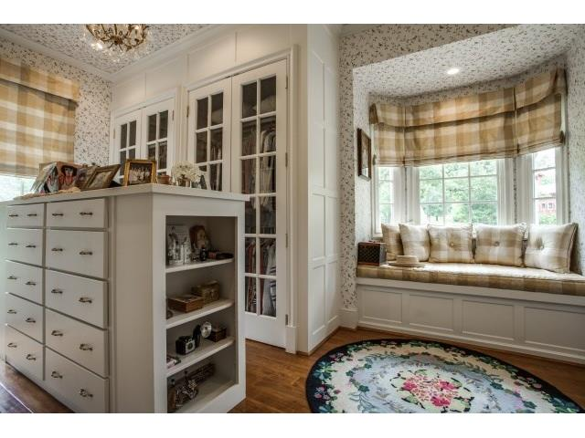"""her"" separate closet with beautiful mill work,drawers, bench se"