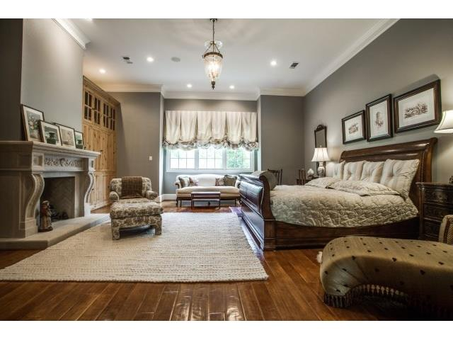 Spacious master with fireplace and sitting area.