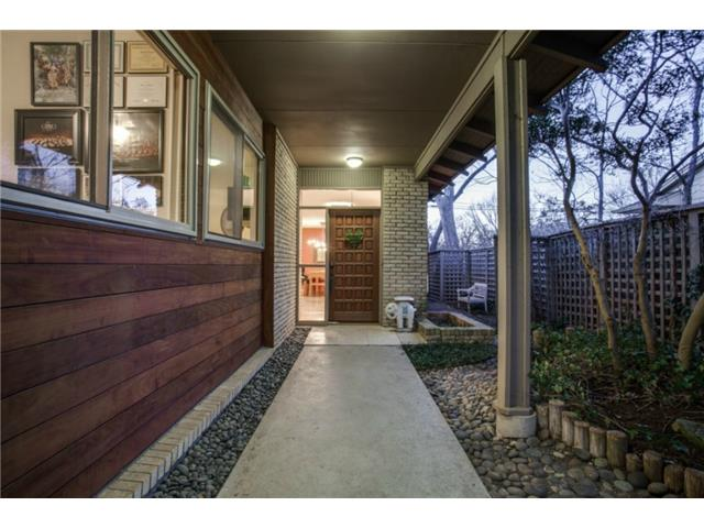 River rock, Ipe siding, new windows and greenery add ambiance to