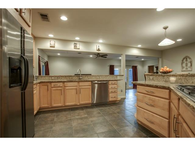Stainless appliances include a gas cook-top, dishwasher, microwa