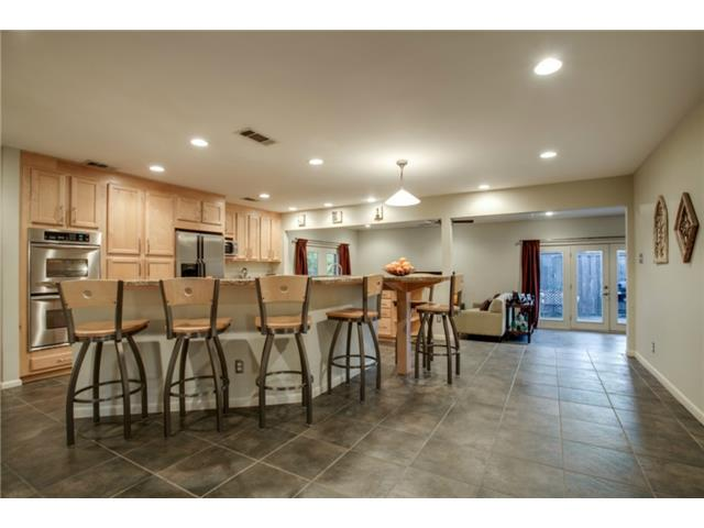 The huge breakfast bar with seating for six will be admired by a