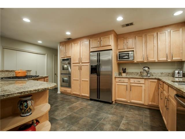 Granite counter tops and an abundance of new cabinets provide mu