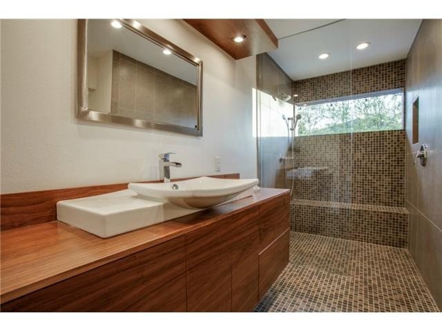 A sleek contemporary design in the new master bath is truly awes