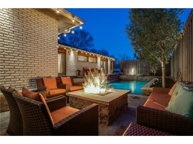 Enjoy the cozy outdoor living area with firepit, the adjacent di