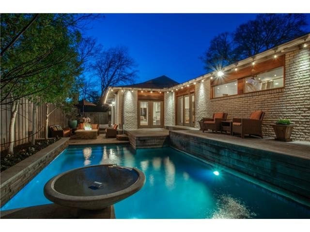 This backyard oasis offers a diamond bright finished pool with w