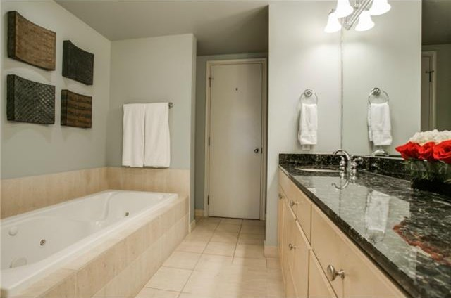 Jetted tub, separate shower and huge custom master closet