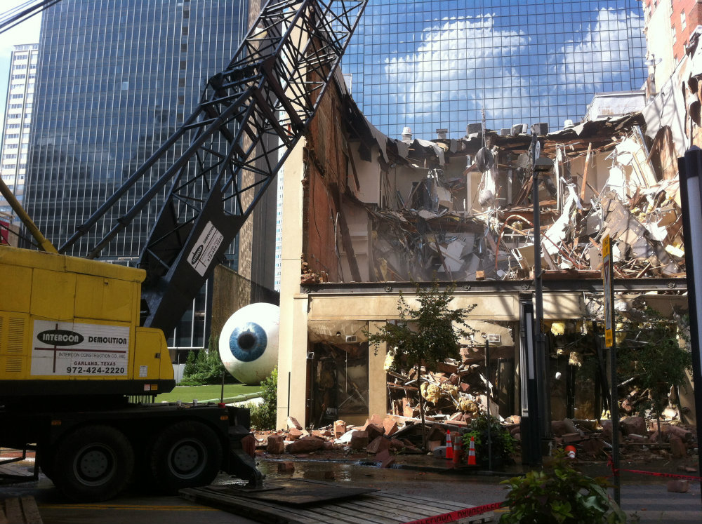 In September 2014, Headington Companies began razing a 129-year-old building in downtown Dallas, and proceeded to demolish almost an entire block of historic storefronts along Main and Elm streets. Photo: Harry Wilonsky/Dallas Morning News