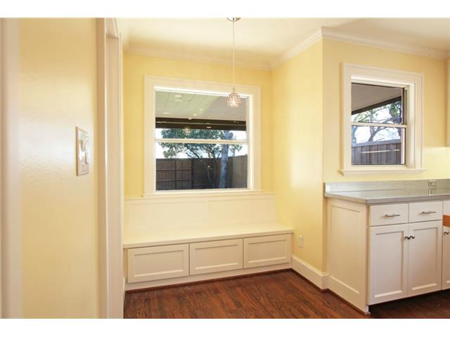 Built-in kitchen banquette with storage space below.