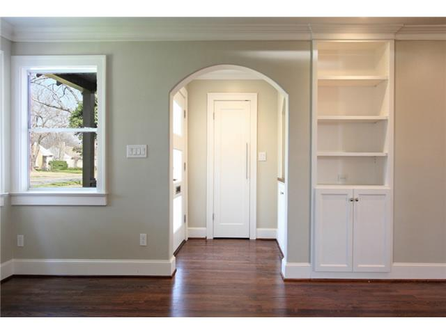 Entrance foyer with coat closet and built-in lighted nook with c