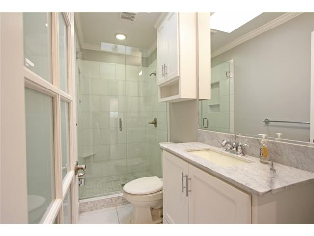 Main bath also includes custom cabinets, marble countertop and a
