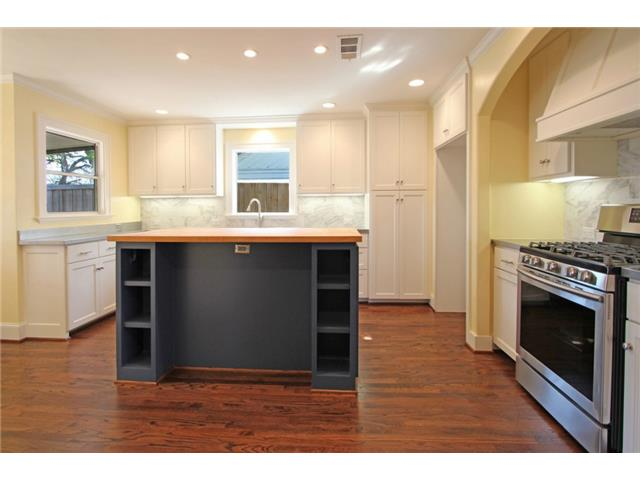 Stunning kitchen with custom cabinets that include a center isla