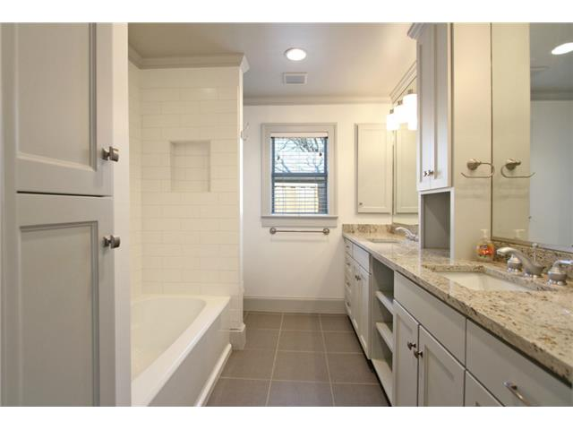 Master Bath features custom cabinet, granite counters, dual sink