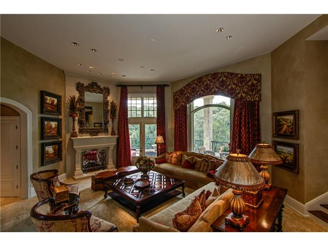 The Elegant Great Room features Soaring Ceilings with Gas Firepl