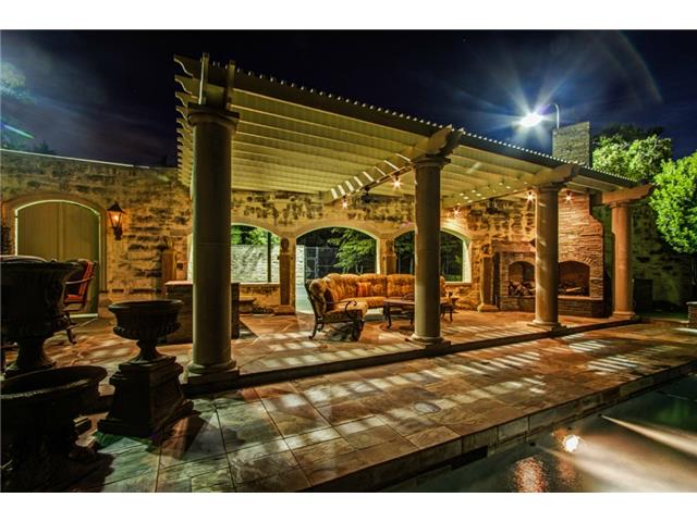 The Loggia features Two Ceiling Fans and an Outdoor Fireplace.