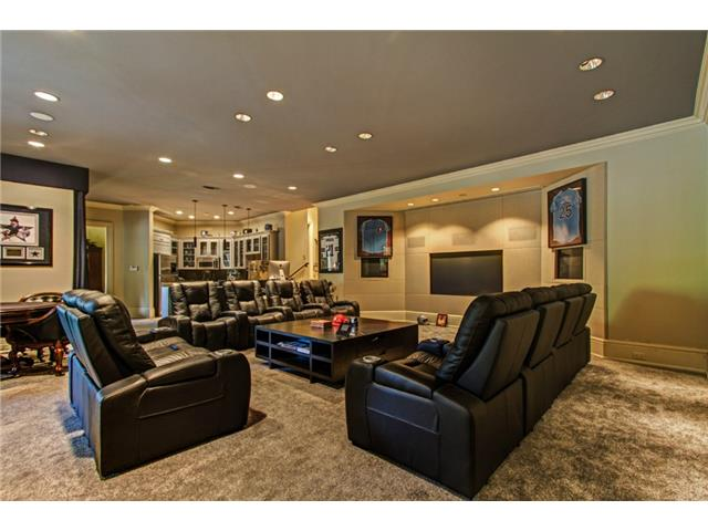 The Media Room features a Custom Built Projection Cabinet, Three