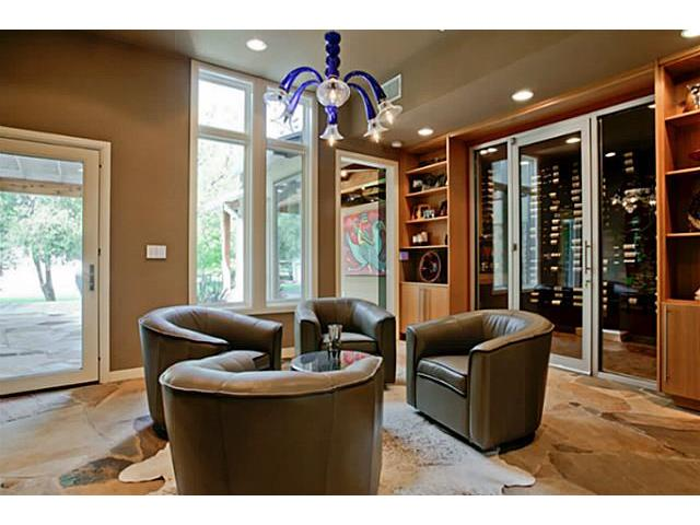 This sitting room next to wine room opens to the back patio