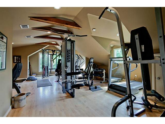 Upstairs workout room joined by half bath; 2 more master suites