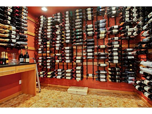 Incredible wine room with cork flooring