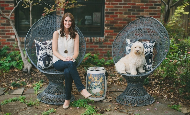 Emily Larkin of EJ Interiors with her pup Zoe in the backyard of her Hollywood Heights home at 707 Cordova.