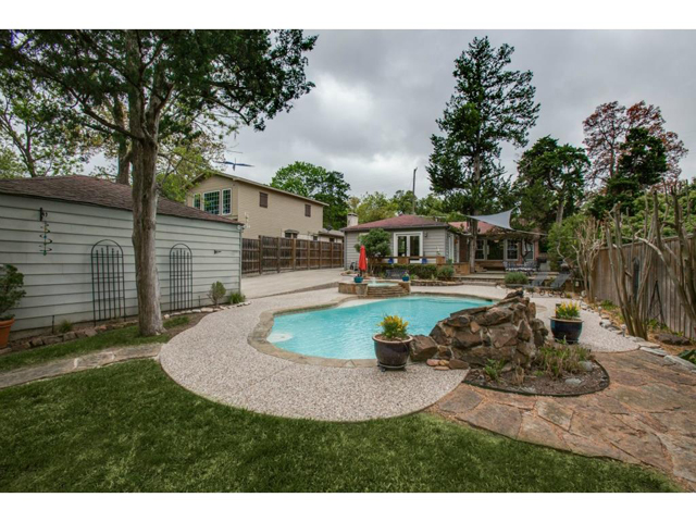 There is ample green space in this oversized lot and perfect for