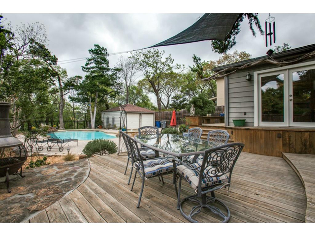 Adjacent to the deck is a special stone patio to house an outdoo
