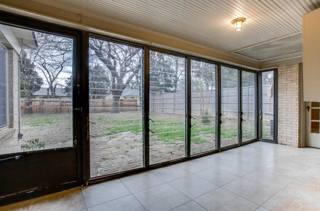 Spacious Sunroom with Glass Louver Windows.  Possible Walk-in Cl