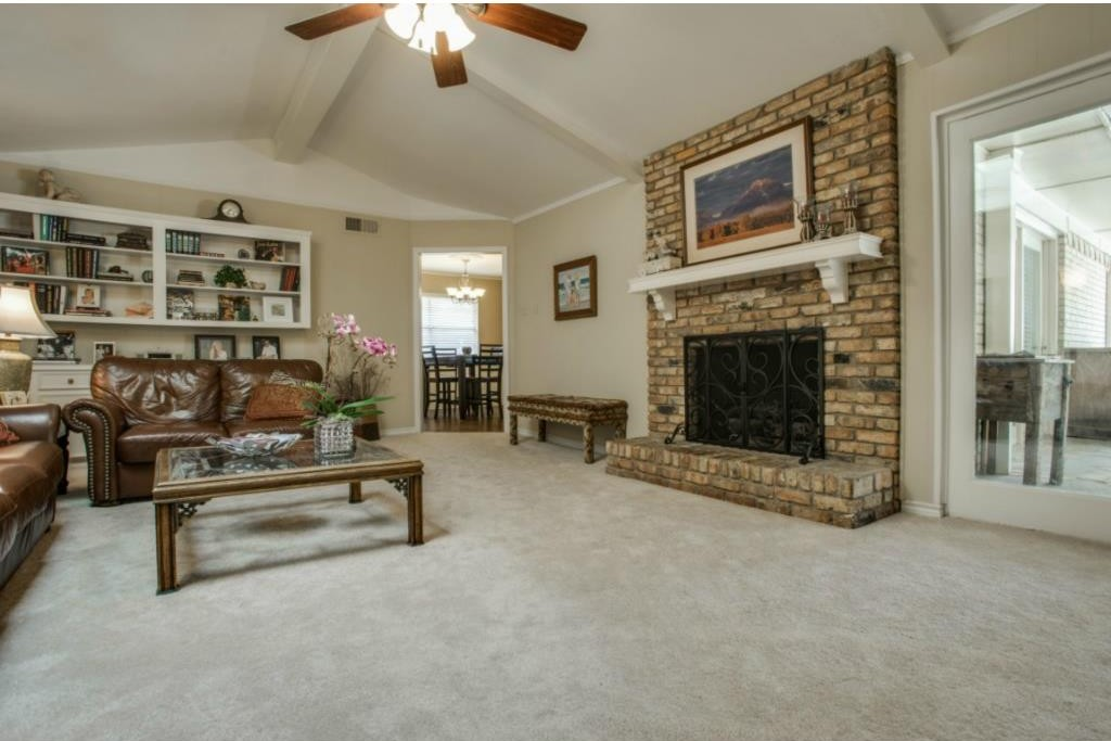 Chair Rail Vaulted Ceiling Part - 28: ... Room With A Gas-log Fireplace With Tan Brick Surround And Built-in  Bookshelves And Cabinets. Love That Vaulted Ceiling With Beams And Large  Skylight.