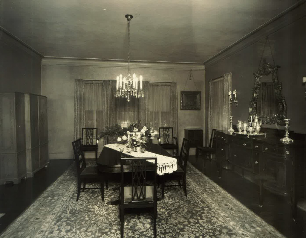 The formal dining room with the original chandelier, which is actually installed in the home next door today.