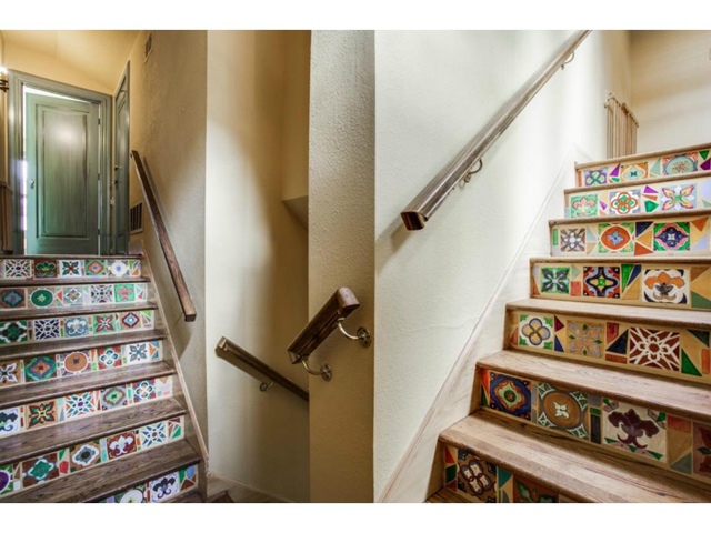 Back staircase with painted wood steps.