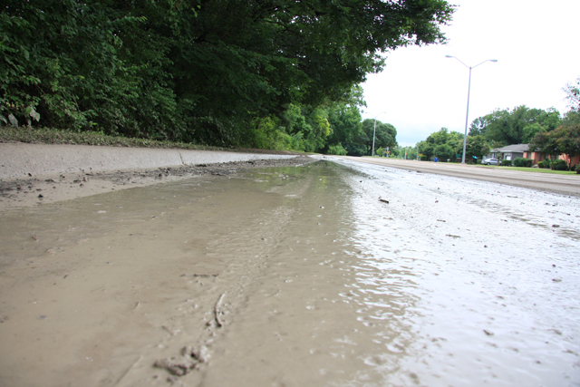 E. Lake Highlands Drive was washed over by the Dixon Branch as last night's storm caused flash flooding in areas throughout East Dallas.