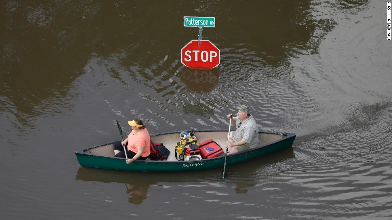 Some Houston residents had to canoe through their neighborhoods during recent floods. (Photo: CNN)
