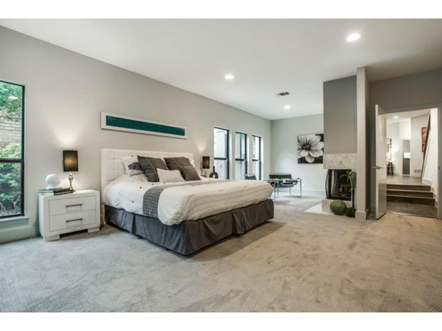 Master suite with its own fireplace, sitting area and desk that