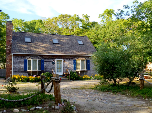 Cedar shake shingles for siding is a classic look for cottages all over Cape Cod. They are left unpainted and turn from light tan to a weathered gray over time. Clapboard siding is also commonly seen on Cape Cod cottages. Photo: Leah Shafer