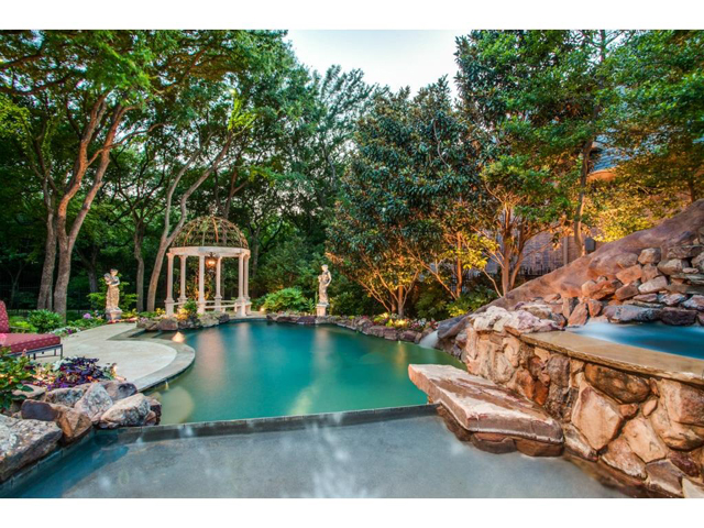 The tranquil backyard has the feel of a mountainside resort that