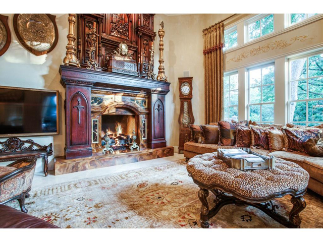 Great room also features a towering imported antique mantle over