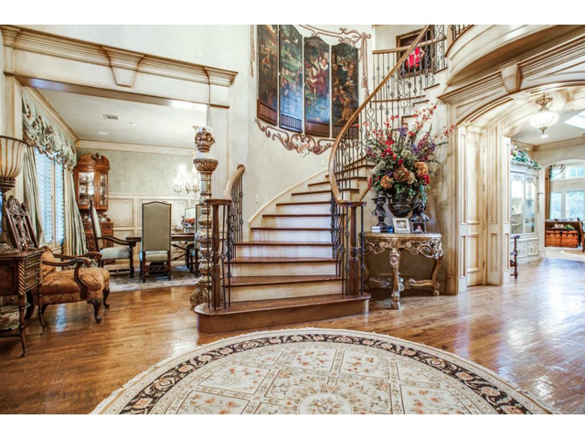 As you enter this exquisite home, be sure to look above to see t