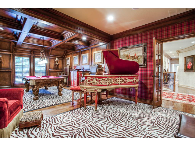 Magnificent upstairs game room features beautiful paneled walls,
