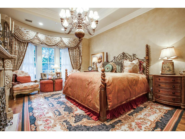 Impeccably designed master suite features bay windows, wood floo