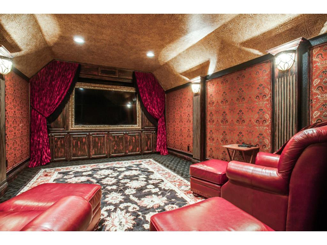 """Lavishly decorated, yet cozy media room is equipped with a 93"""" t"""