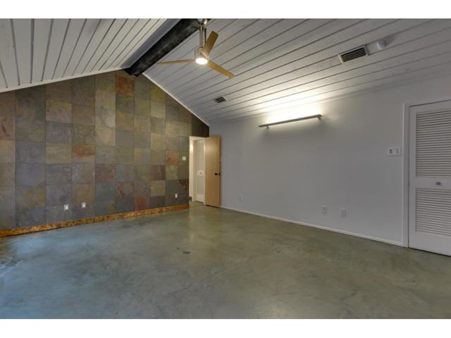 Master Suite: Slate Walls, Artemide wall light.