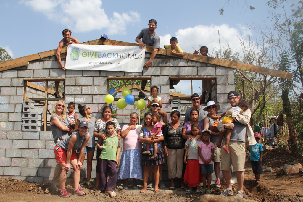 Josefa and her family pose with the team of Realtors building the family's new home. (Photo: Carrie Hill)