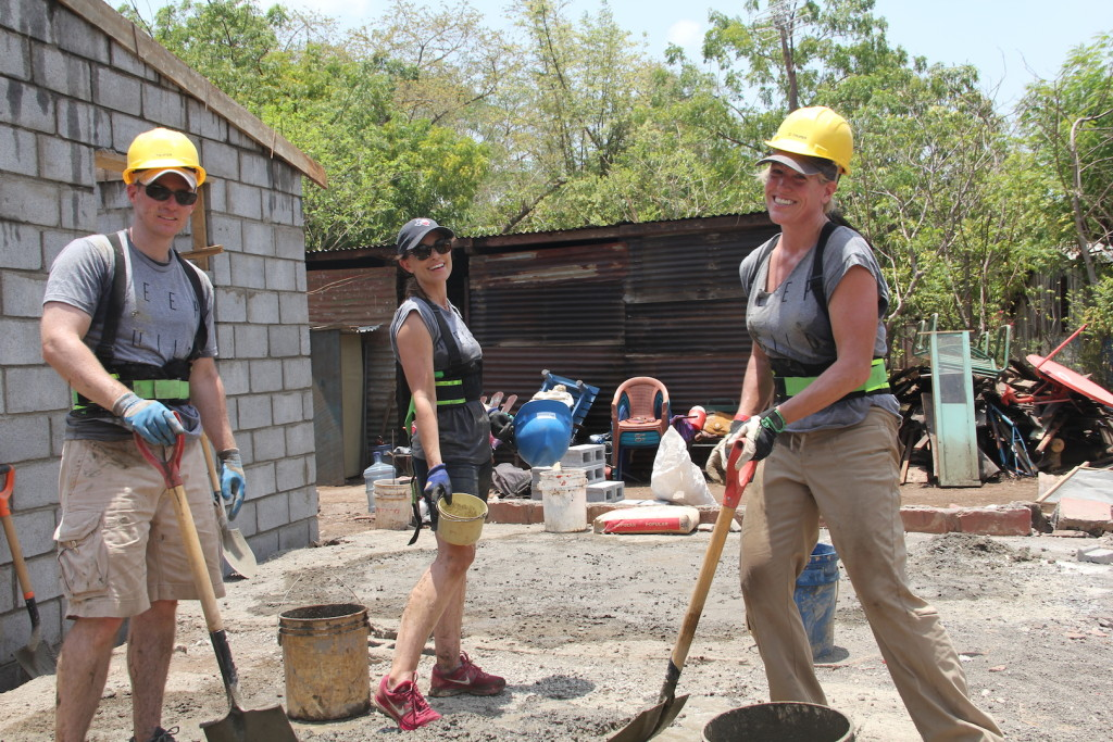 Carrie Hill (center) with fellow Realtors working to build a home for a Nicaraguan family.