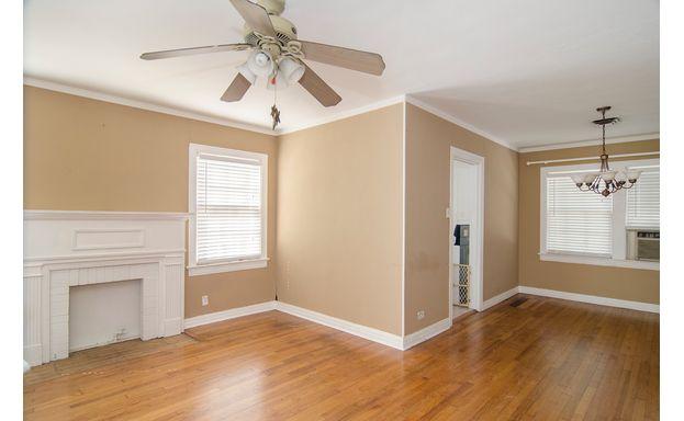 Refinished Floors, Fresh Paint, Decorative Fireplace.
