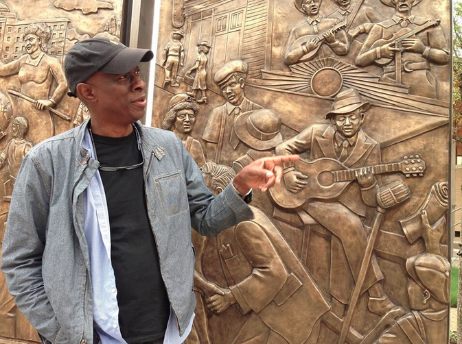 Blues musician Keb Mo gesturing to Mississippi Delta blues Robert Johnson in a panel of the Encore Park bronze sculpture wall, called The Birth of a City, by Dallas artists Brad Oldham and Christy Coltrin. Photo: Jeffrey Liles