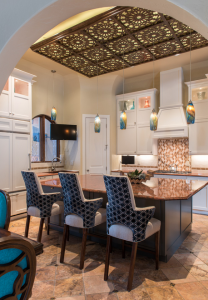 By lightening the ceiling, walls, & cabinets, your eye is now drawn to the custom made moroccan ceiling panel.