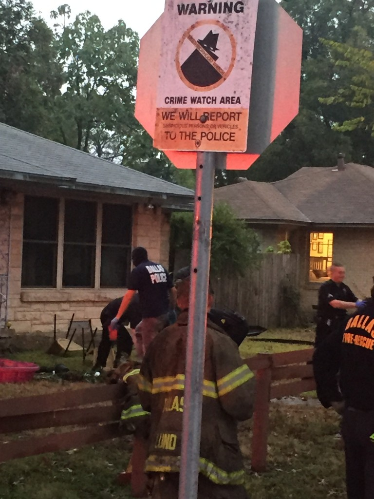 Neighbors appreciated the irony of the 'Crime Watchers' sign at the corner of Peavy and Carnegie, where a marijuana grow operation was found after a house fire. (Photo: Susan Hill)
