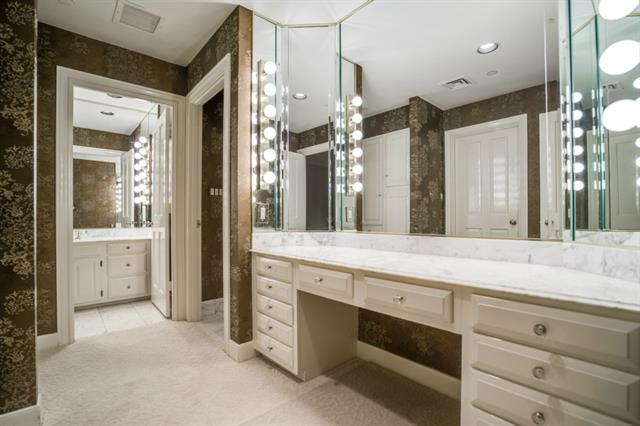 """Her"" bath, complete with runway of make-up space and storage"