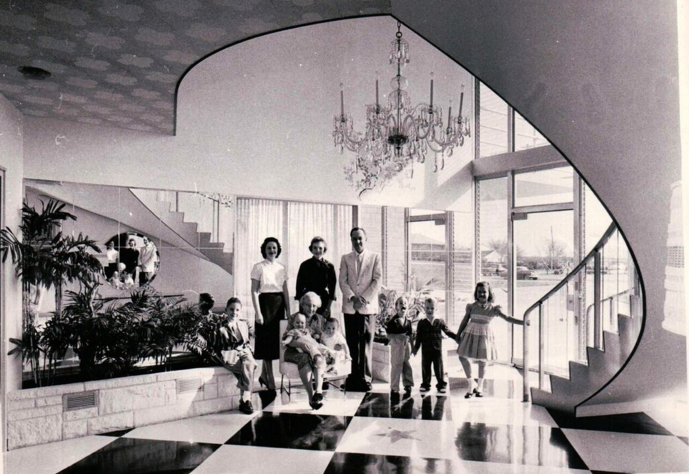The Mayrath family in the grand entryway, late 1950s. Martin Mayrath made his fortune by inventing the grain auger. Photo: Preservation Dallas