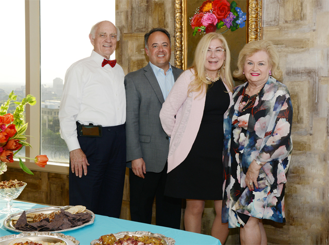 Ebby's Penny Rivenbark and husband Matt Patton flank, Ebby's Little White House manager Matt Patton and Candy