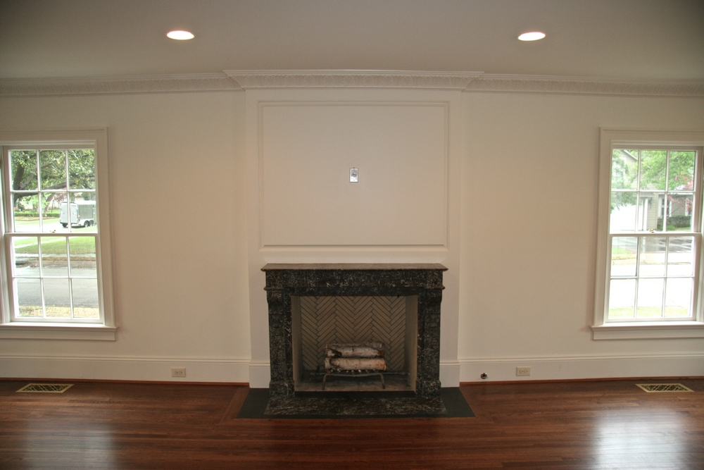 The fireplace is an English antique selected and installed by the Pritchetts.